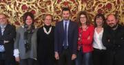 foto di gruppo prefetto Impresa, assessori Aitini e Zaccaria e sei presidenti di quartiere